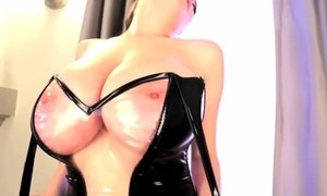 Tessa Fowler takes off a leather dress to show her H cups breasts