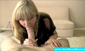 Cougar goes two handed on cock