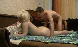 Well-hung lad gives mature woman a good missionary orgasm