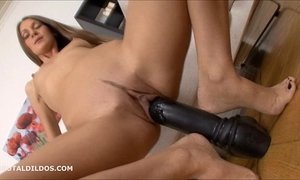 Thin brunette stretching her pussy with thick dildos