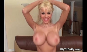 ultra blonde vixen with huge melons gets