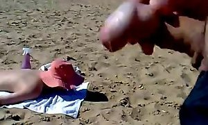 Cumshot milf on beach